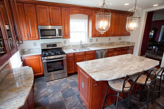 Antique Brown Granite And White Cabinets